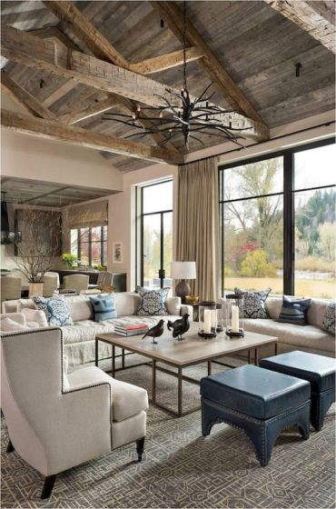 2-a-rustic-farmhouse-living-room-with-much-light-colored-woodcremay-furniture-a-branch-chandelier-and-printed-pillows