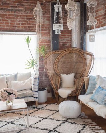 4-06-an-oversized-peacock-chair-with-extended-sides-faux-fur-a-white-pompom-pillow-for-a-boho-living-room