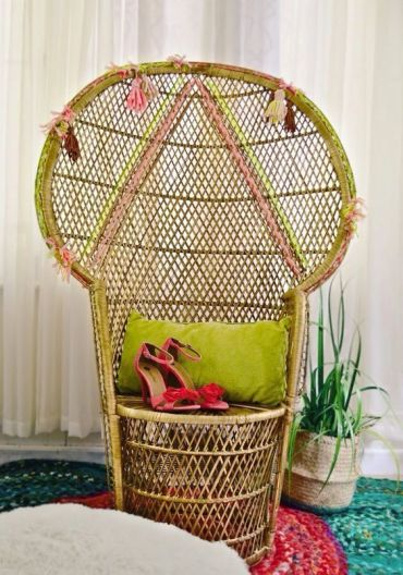 4-18-a-peacock-chair-with-neon-touches-geometric-patterns-done-with-yarn-and-colorful-tassels
