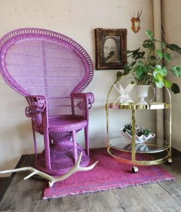 4-19-a-purple-peacock-chair-and-a-matching-rug-is-a-bright-and-non-traditional-idea