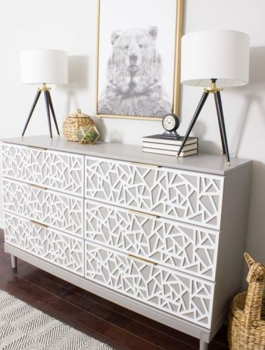 A-creative-tarva-dresser-hack-in-dove-grey-with-white-geometric-inlays-and-tiny-brass-pulls