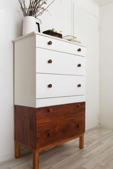 A-half-stained-and-half-painted-white-tarva-dresser-with-stained-knobs-is-a-stylish-option-with-a-rustic-feel