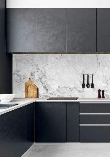 03-a-black-minimalist-kitchen-with-sleek-cabinets-neutral-stoen-countertops-and-a-white-marble-backsplash