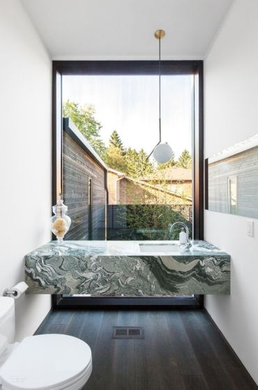 04-a-green-marble-modern-vanity-in-a-small-powder-room-with-a-view-to-the-courtyard