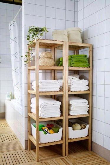 09-molger-shelves-by-ikea-used-for-storing-towels-baskets-with-soaps-and-foams-kids-toys-and-other-stuff