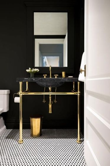 1-15-a-chic-dark-powder-room-accented-with-a-black-marble-sink-on-a-gold-stand-looks-very-exquisite-and-stylish