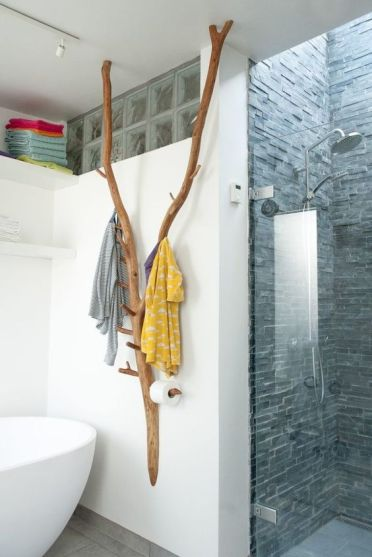 1-a-creative-bathroom-hanger-and-holder-made-of-some-tree-branches-and-hooks-attached-to-them