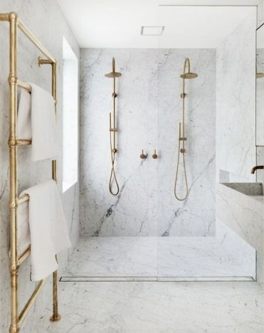 17-an-elegant-white-marble-bathroom-with-brass-and-gold-touches-is-pure-luxury-with-a-modern-feel