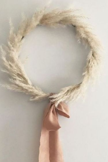 2-a-dried-wheat-wreath-with-a-brown-bow-is-a-cool-fall-decoration-for-any-of-your-spaces