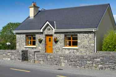 2-stone-house-with-wooden-doors-windows-081018