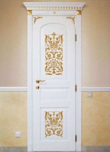 A-white-door-with-gold-ornate-stencils-and-a-gold-handle-looks-very-chic-and-very-stylish