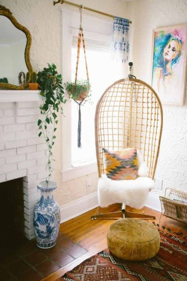 02-a-cozy-wicker-chair-on-a-stand-is-a-must-for-a-boho-or-eclectic-interior