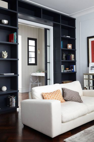 1-dark-and-dashing-doorway-created-using-black-open-shelves-wrapped-around-it