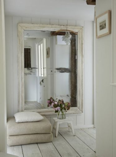 17-an-oversized-mirror-in-a-whitewashed-frame-for-a-scandinavian-entrance