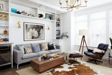 Cowhide-rug-and-metallic-accents-bring-brightness-to-the-light-filled-living-room-33058