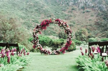 Round-wedding-arch-covered-in-flowers-43953
