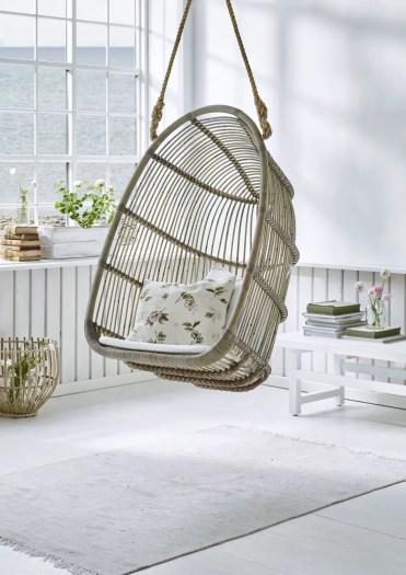 Swing-wicker-chair-hanging-indoor-cool-seating-beach-decor-ideas-fun