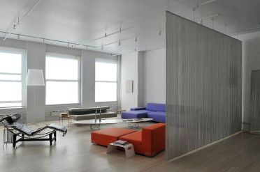Wire-mesh-used-as-room-divider-in-the-contemporary-living-room-of-new-york-home