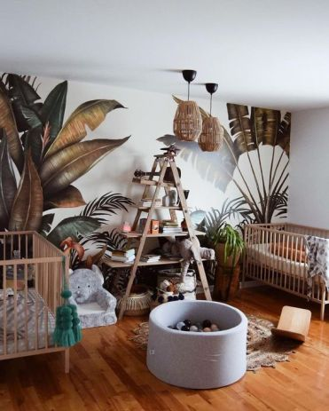 A-jungle-themed-nursery-with-a-printed-leaf-wall-rattan-lamps-an-elephant-chair-and-a-jute-rug