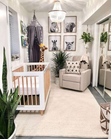 A-jungle-themed-nursery-with-black-and-white-artworks-potted-plants-a-light-canopy-and-printed-textiles