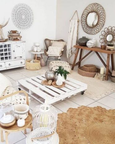 A-whitewashed-boho-living-room-with-shabby-whitewashed-furniture-jute-and-rattan-items-baskets-and-candle-lanterns