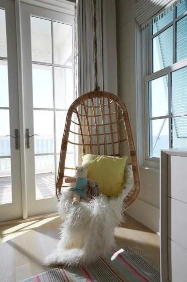 Boys-room-corner-hanging-rattan-chair