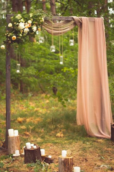 Creative-wedding-arch-ideas-with-florals-manson-jar-lights-and-drapery1
