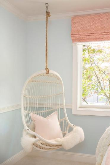 Girls-room-with-corner-white-rattan-hanging-chair