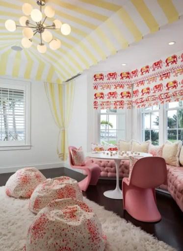 Kids-playroom-canopy-stripe-ceiling-pink-tufted-window-seat-bay-window