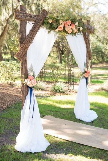 Pink-and-navy-floral-rustic-wedding-arch-decoration-ideas