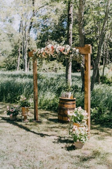 Simple-wood-rustic-wedding-arches-with-flowers-683x1024-1