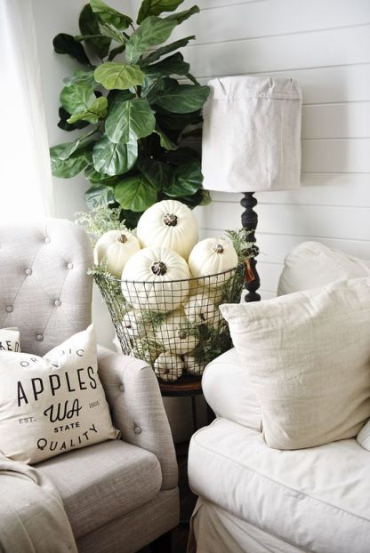 06-a-metal-wire-basket-fulled-with-white-pumpkins-and-greenery-for-a-vintage-inspired-space