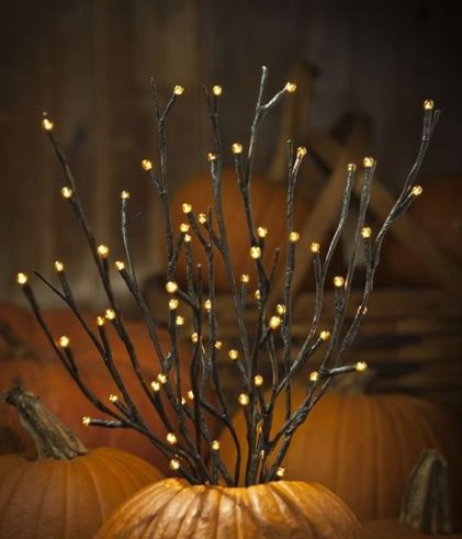 09-orange-led-pre-lit-branches-placed-into-pumpkins-for-fall-displays-1