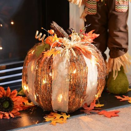 1-04-cute-rattan-pumpkins-with-white-lights-and-a-burlap-bow