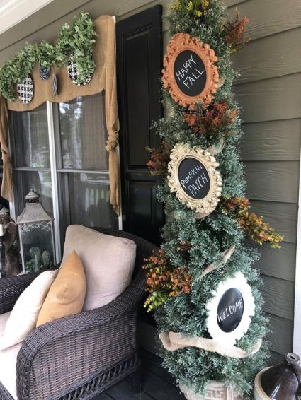 1-a-thanksgiving-tree-with-faux-leaves-and-chalkboard-signs-in-vintage-frames-is-a-stylish-piece-for-indoors-or-outdoors