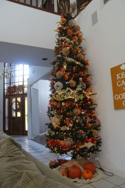 1-a-large-thanksgiving-tree-with-lights-twine-balls-faux-leaves-blooms-grasses-and-fabric-flowers-is-extra-bold