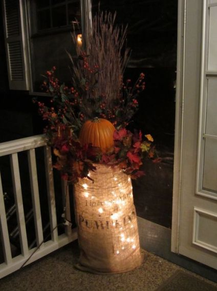 21-lights-in-a-burlap-sack-which-contains-a-bold-fall-arrangement-1