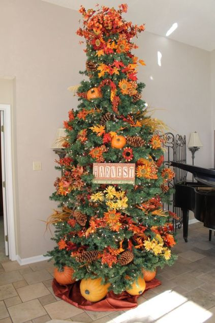 23-a-gorgeous-and-bright-thanksgiving-tree-with-lights-pinecones-bright-faux-blooms-and-leaves-branches-a-sign-and-pumpkins