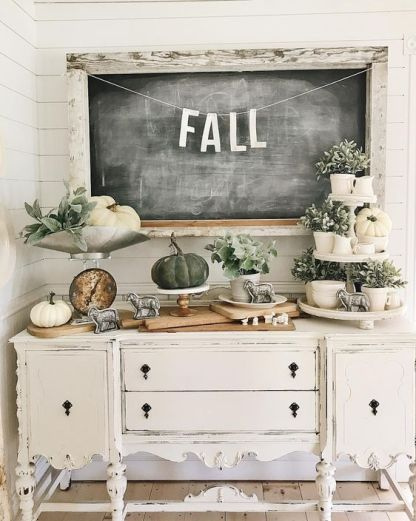 23-a-vintage-carved-console-table-with-white-and-grene-pumpkins-greenery-in-pots-and-vintage-figurines