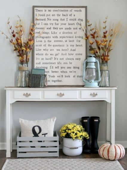 24-a-vintage-console-with-dried-blooms-and-herbs-a-lantern-and-a-natural-pumpkin-on-the-floor