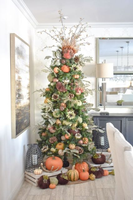 A-thanksgiving-tree-with-faux-and-velvet-pumpkins-pinecones-foliage-greenery-and-branches-with-berries-plus-more-pumpkins-under-it