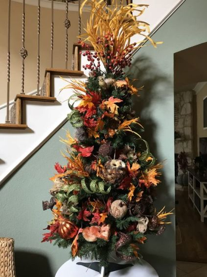 A-thanksgiving-tree-with-leaves-faux-and-fabric-pumpkins-faux-leaves-husks-berries-and-glitter-ribbons