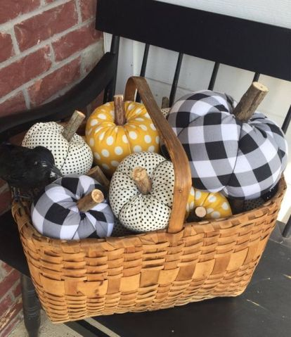 A-basket-with-faux-pumpkins-of-plaid-and-polka-dot-fabric-are-stylish-for-fall-or-halloween