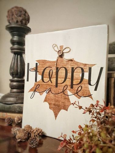 A-beautiful-fall-sign-in-white-and-with-a-stained-fall-leaf-and-a-button-is-super-cute-and-fun