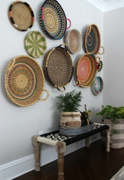 A-bright-boho-entry-with-a-woven-bench-colorful-decorative-baskets-and-potted-plants-in-printed-planters