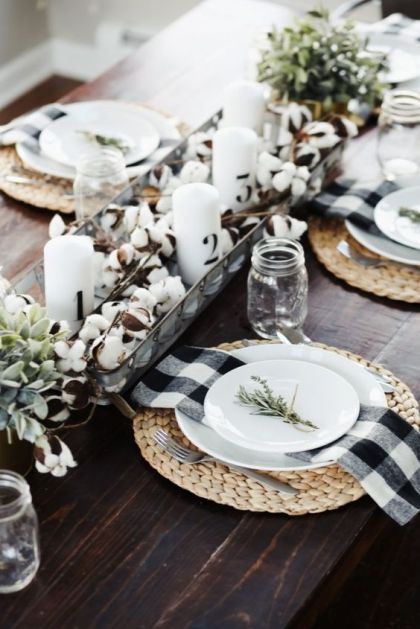 A-cool-fall-centerpiece-of-cotton-greenery-and-candles-woven-placemats-and-plaid-napkins