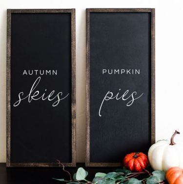 A-duo-of-chalkboard-signs-with-white-letters-is-a-stylish-idea-to-spruce-up-your-mantel-for-the-fall
