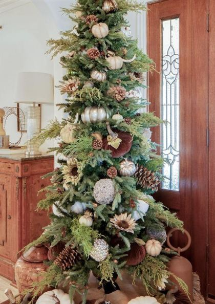 A-fabulous-thanksgiving-tree-with-white-silver-and-velvet-pumpkins-greenery-pinecones-antlers-and-some-more-pumpkins-under-it