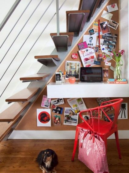 A-floating-drawer-desk-a-corkboard-and-a-chair-for-a-little-and-colorful-work-nook-under-the-stairs