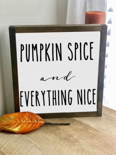A-laconic-fall-sign-in-a-stained-frame-and-with-black-letters-for-outdoor-or-indoor-fall-decor